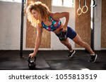 fit young woman looking focused ... | Shutterstock . vector #1055813519