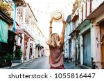 boho girl walking on the city... | Shutterstock . vector #1055816447