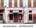 boho girl walking on the city... | Shutterstock . vector #1055816459