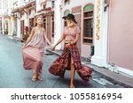 boho mom with daughter in maxi... | Shutterstock . vector #1055816954