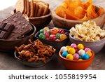 salty snacks. pretzels  chips ... | Shutterstock . vector #1055819954
