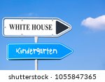 Small photo of two street signs with arrows to the right side, showing the way to the white house and to the kindergarten, concept concerning american politic affairs