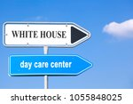 Small photo of two street signs with arrows to the right side, showing the way to the white house and to the day care center, concept concerning american politic affairs
