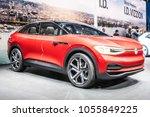 Small photo of Geneva, Switzerland, March 06, 2018: metallic red Volkswagen VW I.D. CROZZ Concept autonomous electric SUV car ID at 88th Geneva International Motor Show GIMS, sporty, zero-emission all-round vehicle