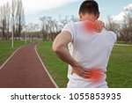 sport injury  man with back... | Shutterstock . vector #1055853935