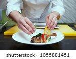chef is decorating duck leg...   Shutterstock . vector #1055881451