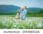 happy mother and daughter child ... | Shutterstock . vector #1055883164