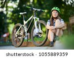 female cyclist in professional... | Shutterstock . vector #1055889359