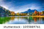 picturesque autumn scene of... | Shutterstock . vector #1055889761