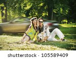 Smiling people with happy dog - stock photo