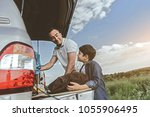 side view of excited boy taking ... | Shutterstock . vector #1055906495