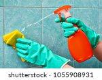 hands in green rubber... | Shutterstock . vector #1055908931