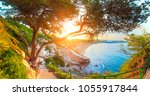 beautiful sunny seascape. green ... | Shutterstock . vector #1055917844