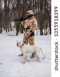 Small photo of Airsoft model(s) posing with weapons and a dog