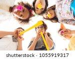 bottom view. joyful children... | Shutterstock . vector #1055919317