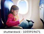 adorable little girl traveling... | Shutterstock . vector #1055919671
