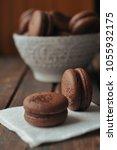 brown macarooni lie on a napkin ... | Shutterstock . vector #1055932175