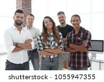successful team of young people | Shutterstock . vector #1055947355