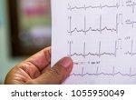 doctor looking at...   Shutterstock . vector #1055950049