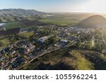 aerial view of farm fields and... | Shutterstock . vector #1055962241