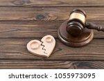 two wedding rings on a broken... | Shutterstock . vector #1055973095