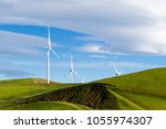 wind turbines on the hills of... | Shutterstock . vector #1055974307
