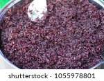 black sticky rice at local... | Shutterstock . vector #1055978801