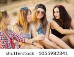 girlfriends have fun and drink... | Shutterstock . vector #1055982341