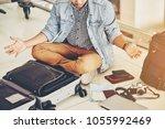 an asian male traveler is...   Shutterstock . vector #1055992469