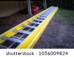 Yellow Ladder On The Ground
