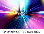 moving traffic light trails at... | Shutterstock . vector #1056015839