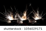 lighter ignition close up sparks | Shutterstock . vector #1056029171