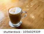 coffee cup on table | Shutterstock . vector #1056029339