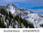 downhill skiing in telluride ...   Shutterstock . vector #1056040925