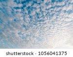 pattern of cirrocumulus cloud... | Shutterstock . vector #1056041375