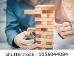 hands of business man playing a ...   Shutterstock . vector #1056044084