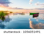 a beautiful sunset on the shore ... | Shutterstock . vector #1056051491