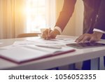 male manager putting his ideas... | Shutterstock . vector #1056052355