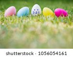 row of easter eggs in fresh... | Shutterstock . vector #1056054161