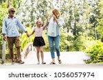 happy family having fun... | Shutterstock . vector #1056057974