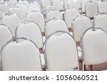 white chairs arranged in a... | Shutterstock . vector #1056060521