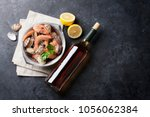 fresh seafood and white wine on ... | Shutterstock . vector #1056062384