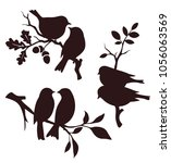 vector set of birds and twigs.... | Shutterstock .eps vector #1056063569