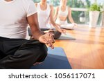 group of meditating people ... | Shutterstock . vector #1056117071