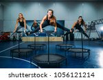 women group on sport trampoline ... | Shutterstock . vector #1056121214