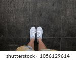 a girl take photo of her white... | Shutterstock . vector #1056129614