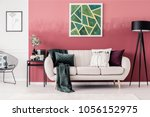 white sofa with blanket and... | Shutterstock . vector #1056152975
