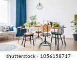 wooden and metal black chairs... | Shutterstock . vector #1056158717