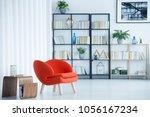 orange armchair next to wooden... | Shutterstock . vector #1056167234
