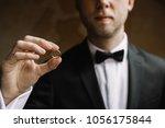 groom holding wedding rings on... | Shutterstock . vector #1056175844